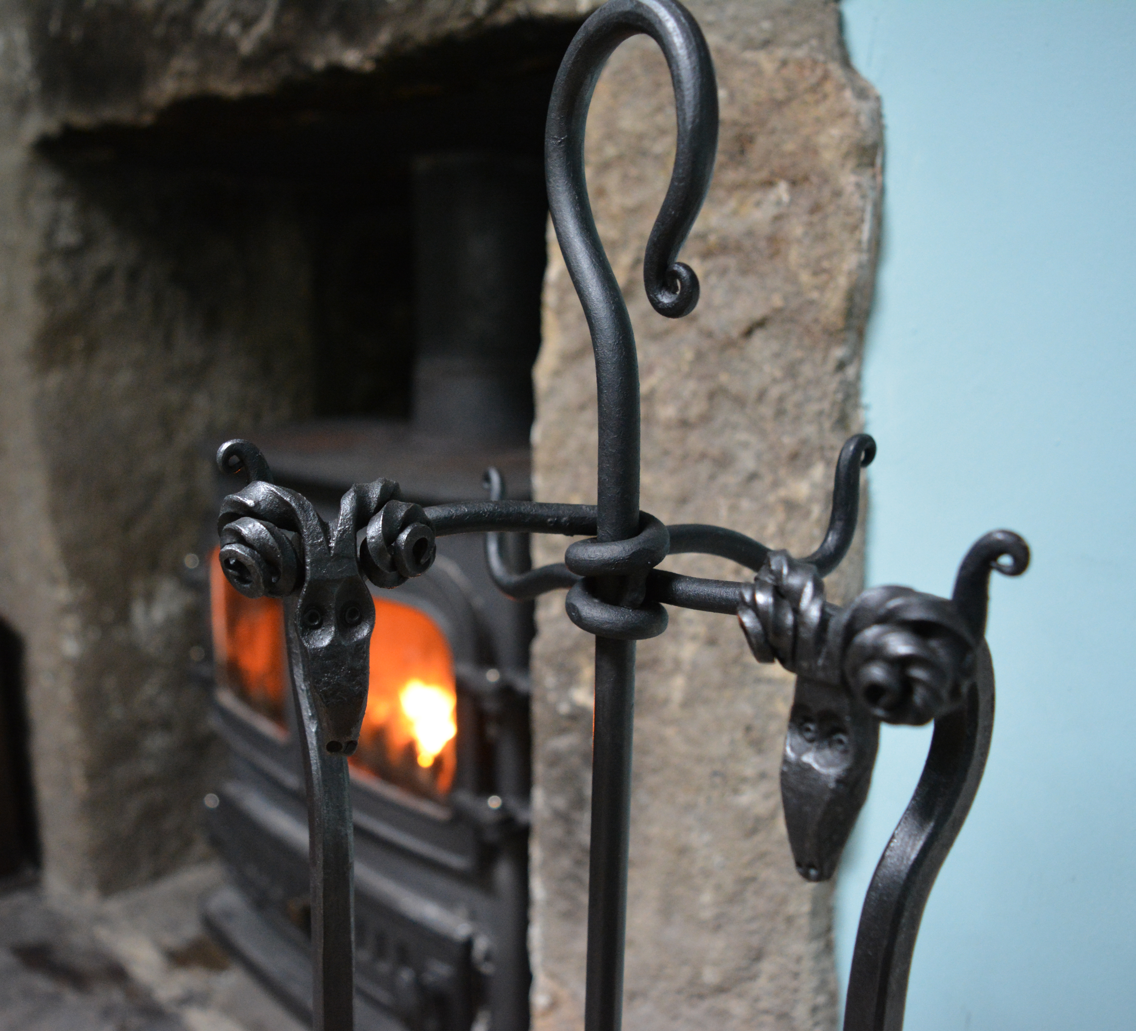 Ram's head fire tools on a traditional stand from the Malham Smithy